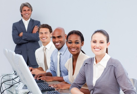 customer services: Happy customer service representatives in a call-center