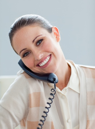 Positive businesswoman talking on phone photo