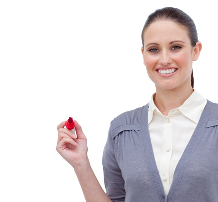 Smiling attractive businesswoman holding a marker  photo