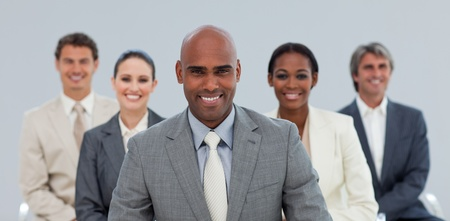 Charismatic Ethnic businessman with his team smiling Stock Photo - 10256171
