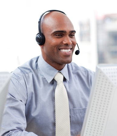 telemarketing: Confident businessman working at a computer Stock Photo