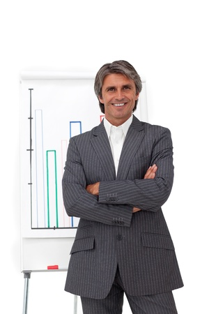Charismatic mature businessman with folded arms  photo