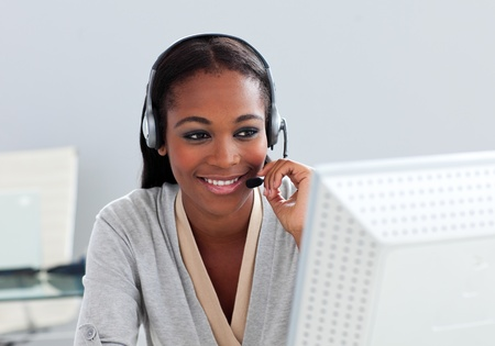 assertive: Assertive ethnic customer service agent with headset on  Stock Photo