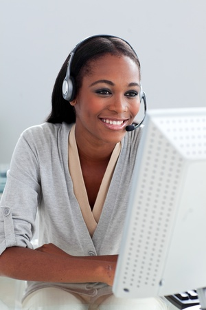Self-assured customer service representative with headset on  photo