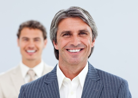 Portrait of two smiling businessmen photo