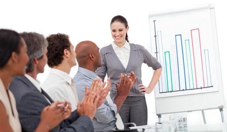 Cheerful business people clapping a good presentation photo