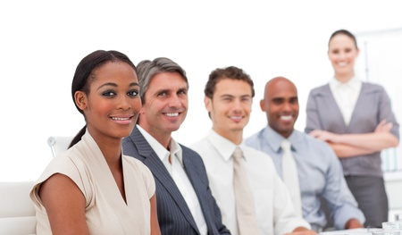Positive business team smiling at the camera Stock Photo - 10232834