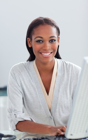 Confident businesswoman working at a computer Stock Photo - 10259055
