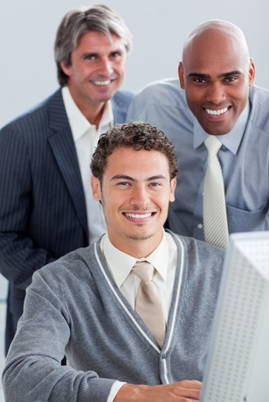 Charismatic business partners working at a computer Stock Photo - 10257222
