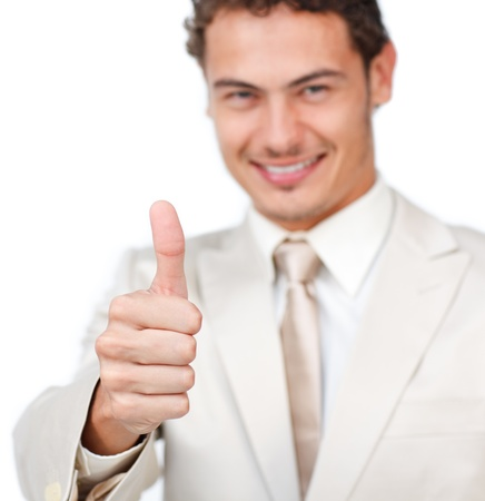 Close-up of a smiling businessman with thumb up photo