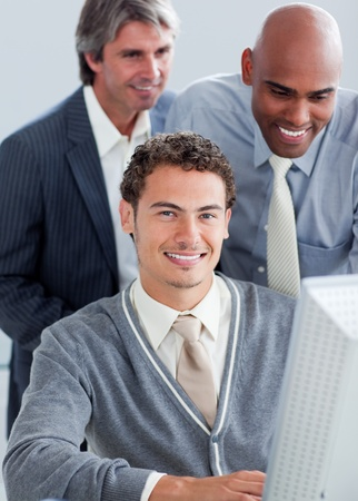 Handsome businessmen working at a computer photo