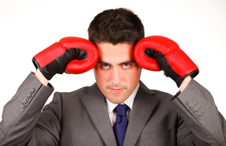 Stressed businessman with boxing gloves Stock Photo - 10240528