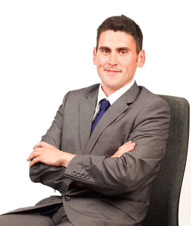 Confident businessman relaxing on a chair photo