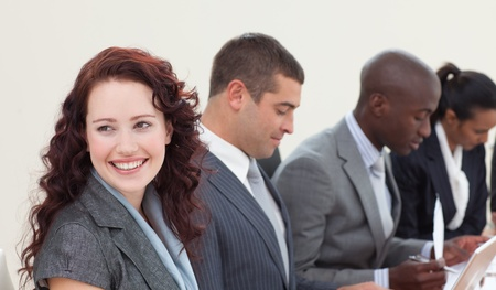 Smiling brunette businesswoman in a meeting Stock Photo - 10241886