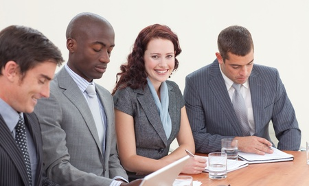 Smiling businesswoman working in a meeting Stock Photo - 10238386