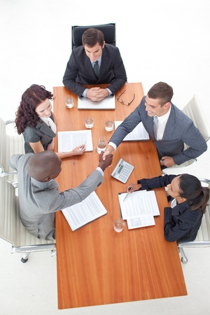 High angle of businessmen shaking hands in a meeting Stock Photo - 10222044
