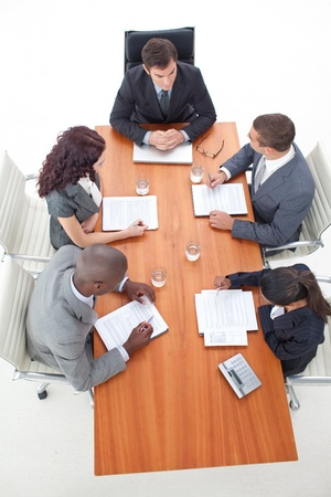 High Angle of business people having a meeting photo