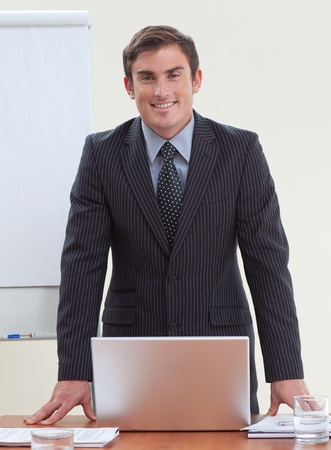 Confident attractive businessman in office smiling  photo