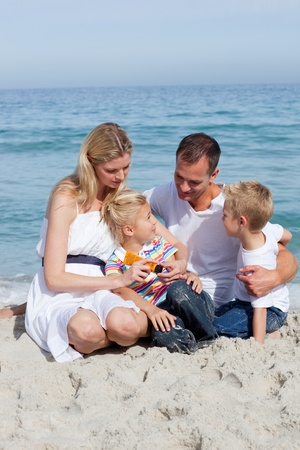 Caring mother with her family holding sunscreen photo