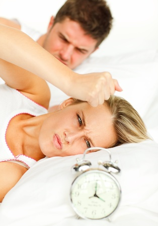 Angry couple lying on their bed photo