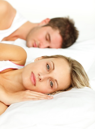 Portrait of a tired couple sleeping on their bed Stock Photo - 10256186