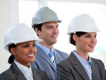 A diverse team of architects standing during at a conference Stock Photo - 10243248
