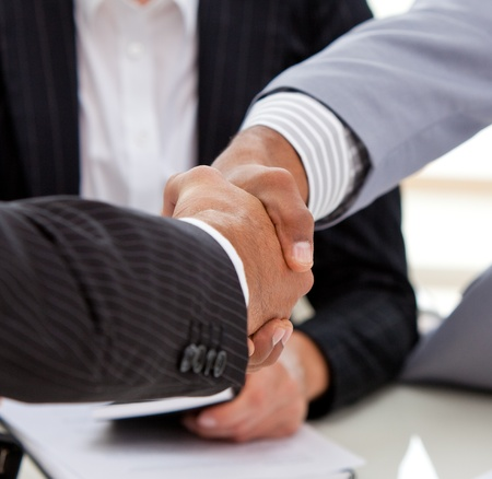 Close-up of businessmen closing a deal photo
