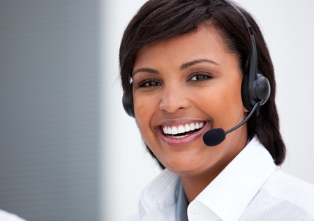 Portrait of an ethnic customer service agent at work photo