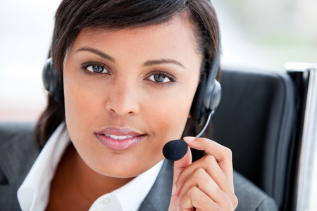 Portrait of a charming customer service agent at work photo