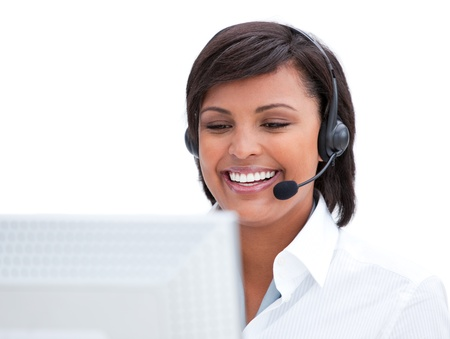 Portrait of a customer service agent working at a computer photo