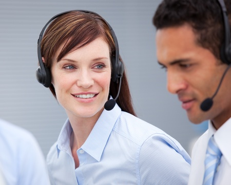 Close-up of a female customer service agent and hercolleague Stock Photo - 10257345