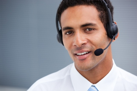 Portrait of a handsome customer service agent at work photo