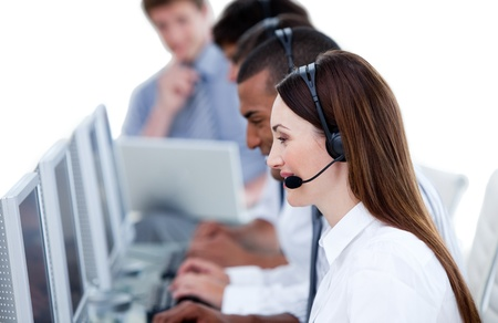 Smiling business team working in a call center   photo