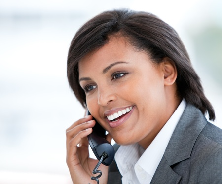 Portrait of an elegant business woman talking on phone photo