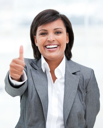 Portrait of a fortunate business woman with a thumb up Stock Photo - 10232157