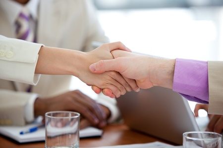 Close-up of two business people shaking hands photo
