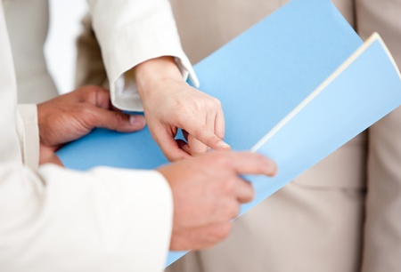 Close-up of a businesswoman pointing at a document photo
