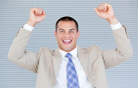 Successful businessman puniching the air photo