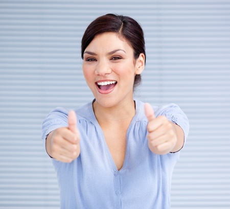 Successful businesswoman with thumbs up photo
