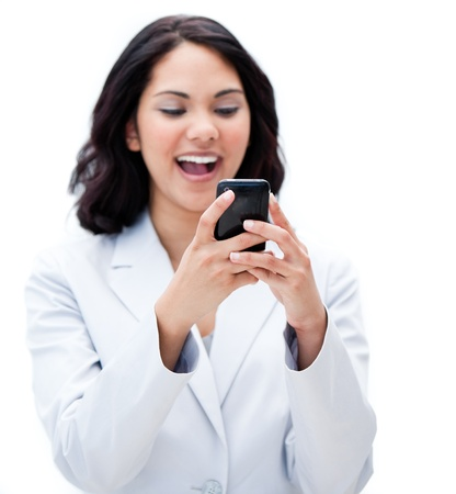 answering the phone: Portrait of a jolly businesswoman sending a text Stock Photo