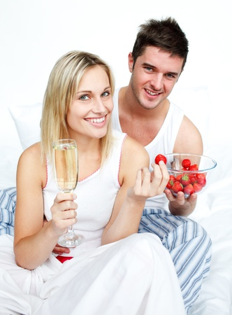 Loves eating strawberries and drinking champagne photo