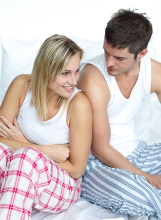 Couple having fun sitting in bed photo