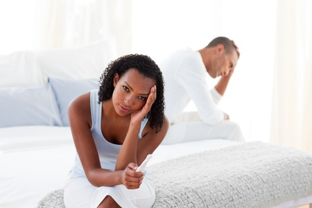 Disconcerted couple finding out results of a pregnancy test  photo