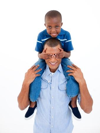 Father giving his son piggiback ride photo