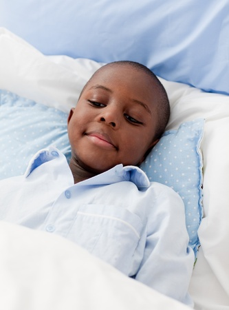 Little boy sick in bed photo