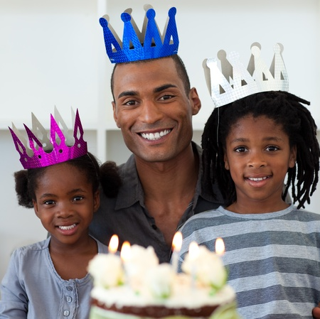 Smiling father with his children celebrating a birthday  photo