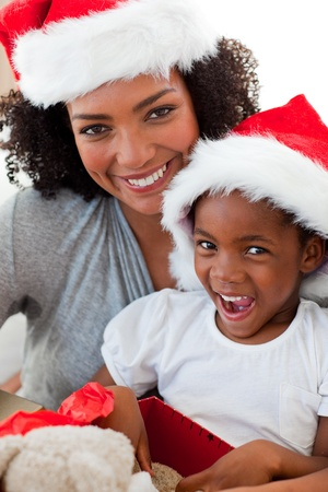 Mother and daughter having fun at Christmas time photo
