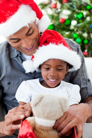 Happy father and daughter playing with Christmas gifts Stock Photo - 10238646