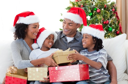 Afro-American family celebrating Christmas at home photo