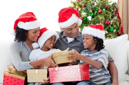 Afro-American family holding Christmas gifts photo
